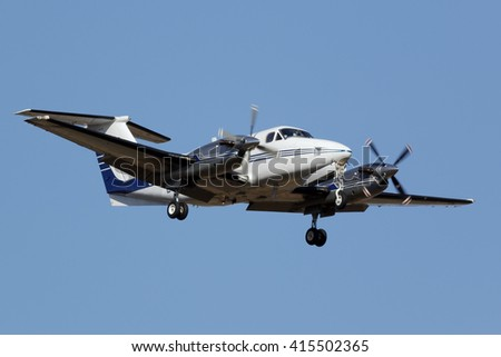 Small turboprop airplane approaching the runway - stock photo
