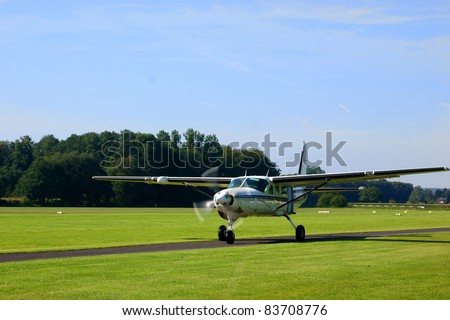 Small turboprop plane after landing - stock photo