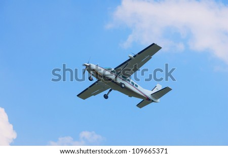 Small turboprop plane against a blue sky - stock photo