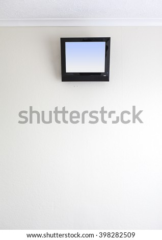small TV on motel wall
