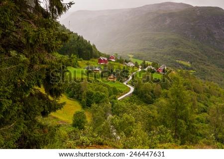 Small village of Naeroydalen valley - spruce left foreground, Norway, Scandinavia - stock photo