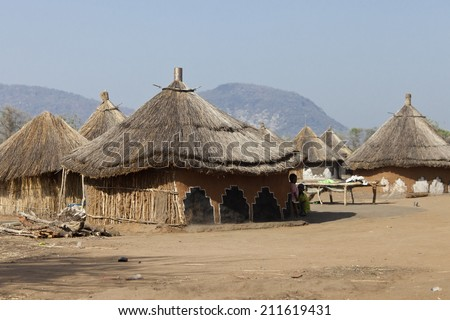 Small village of thatched huts in South Sudan - stock photo