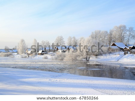 small village on coast river - stock photo