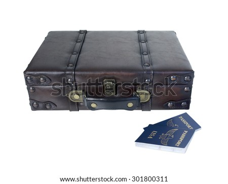 Small vintage briefcase to carry clothing and essentials when traveling with passports - path included - stock photo