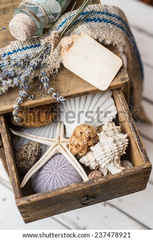 Small vintage drawer with summer souvenirs inside - stock photo