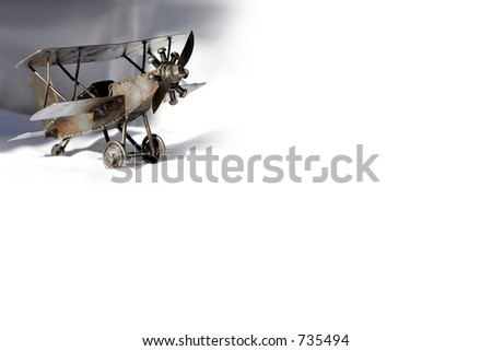 Small vintage metal barnstormer Bi-Plane - represents aviation and travel. - stock photo