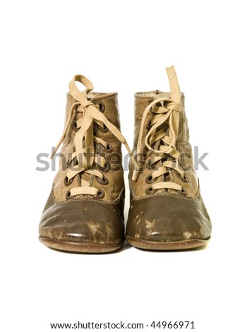 Small vintage shoes on white background