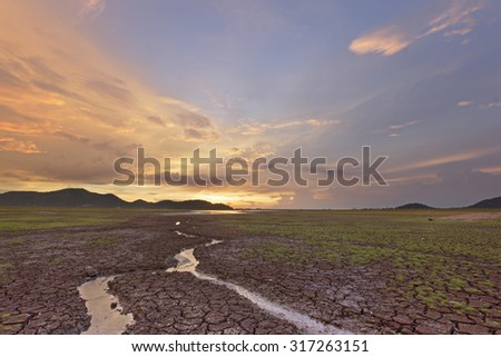 Small water way through crack earth with background twilight