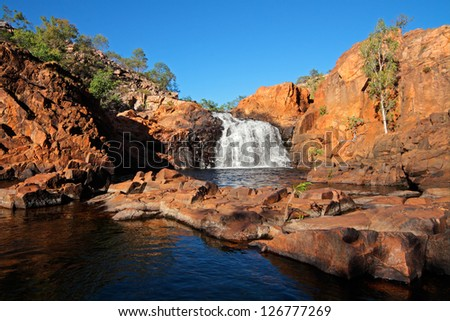 Small waterfall and pool with clear water, Kakadu National Park, Northern Territory, Australia - stock photo