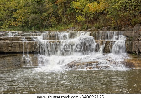 Small Waterfall At The Entrance Of Taughannock Falls State Park In New York - stock photo