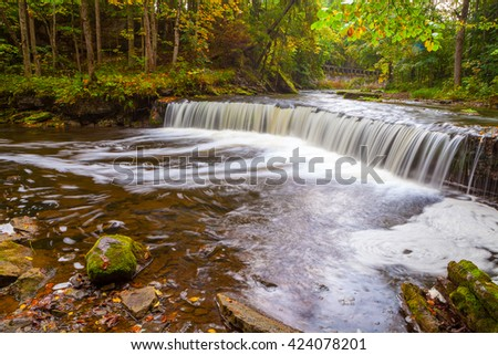 Small waterfall (cascade) on river with motion blur. Lahemaa national park, Estonia - stock photo
