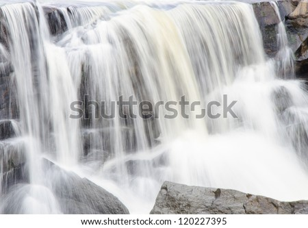 Small waterfall from the rock cliff in the national park. - stock photo