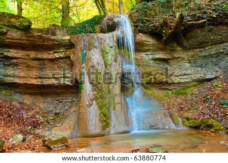 small waterfall in a mountains - stock photo