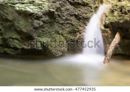 Small Waterfall in Forest, Moss Covered Rocks