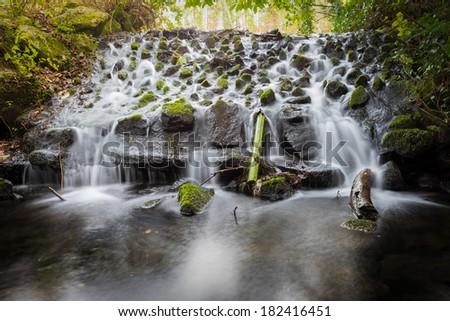 Small waterfall in Marlay Park Dublin Ireland - stock photo