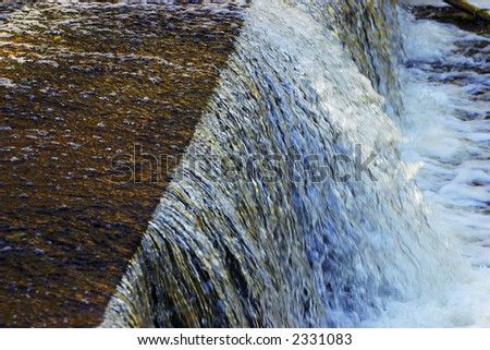 Small waterfall in the brook. - stock photo
