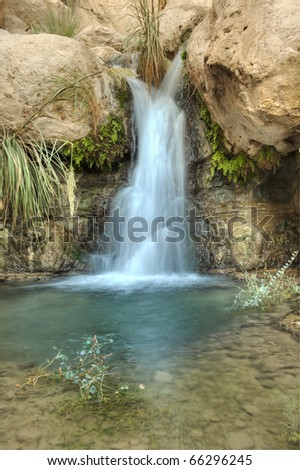 Small Waterfall in the desert in Nahal David near Ein Gedi, Israel - stock photo