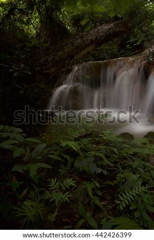 Small waterfall in the forest of Northern Thailand.