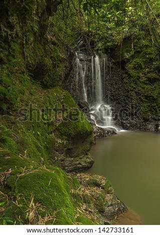 Small waterfall located near El Cajon de Grecia Costa Rica. - stock photo