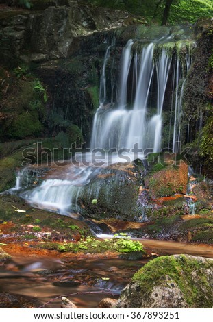 Small waterfall on a creek Ponikly in mountains Jeseniky - stock photo