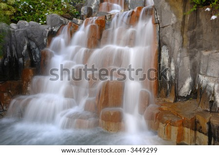 Small waterfall. The water is in motion blur.