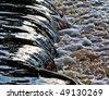 small waterfall with foam closeup background - stock photo