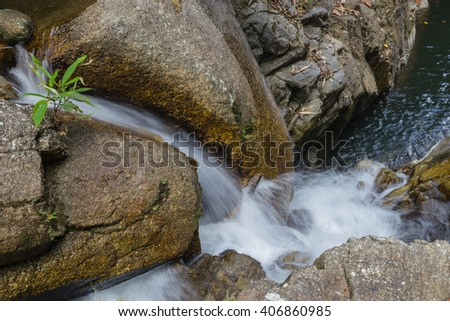 Small waterfalls in tropical forest - stock photo