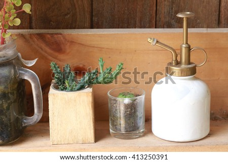 small watering can - stock photo