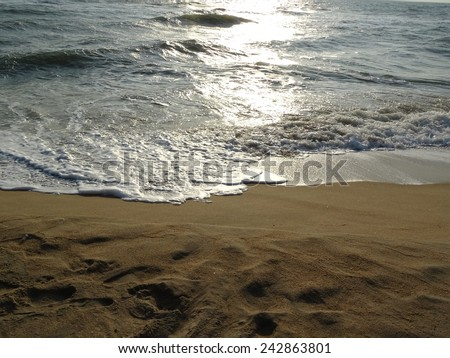 small wave on the beach for background - stock photo