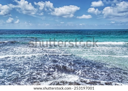 small waves by the coast in Sardinia. Processed for hdr tone mapping effect - stock photo