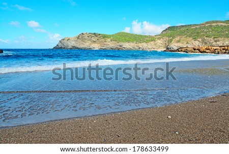 small waves in L'Argentiera shoreline