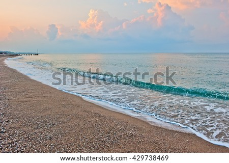 small waves of the sea at dawn - stock photo