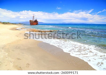Small waves on Selinitsa beach and distant shipwreck, Gythio, Greece