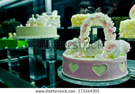 small wedding cake with swans figures - stock photo