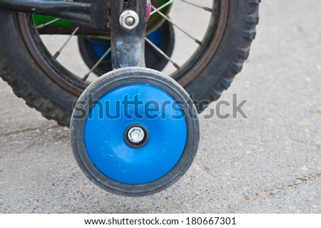 Small wheel of the child bicycle - stock photo