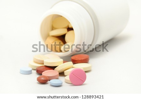 small white boat with color medicines