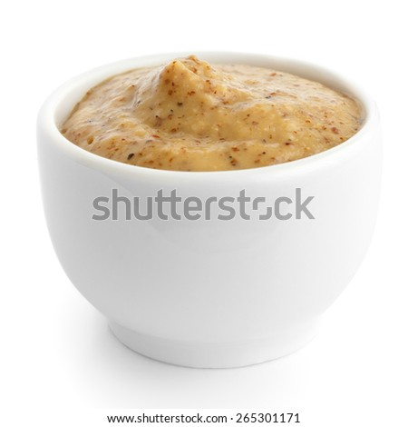 Small white ceramic dish of Czech mustard. Isolated. - stock photo