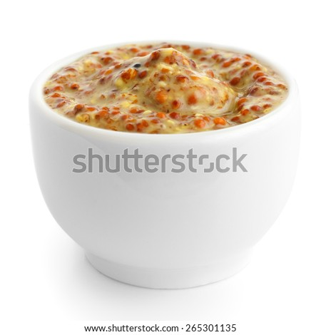 Small white ceramic dish of French mustard. Isolated. - stock photo