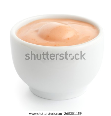 Small white ceramic dish of pink dressing. Isolated. - stock photo