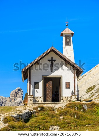 Small white chapel in Tre Cime National Park, Dolomites Mountains, Italy - stock photo