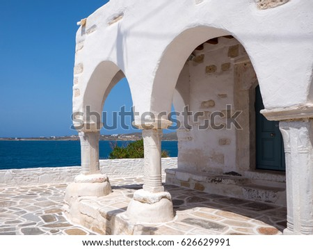 Small white church by the sea in Paros, Greece