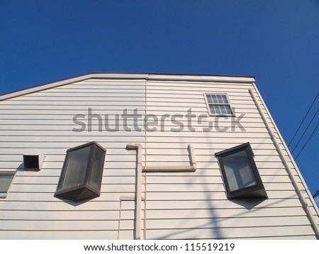 small white house and blue sky