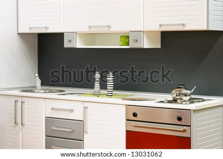 Small white kitchen with stove and sink