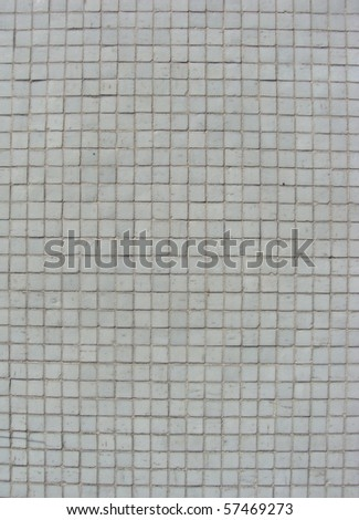 small white mosaic tiles on a wall - stock photo