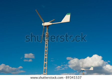 Small wind generator as used to privately power a single home - stock photo