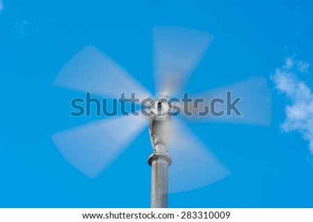 Small wind turbine in motion - stock photo