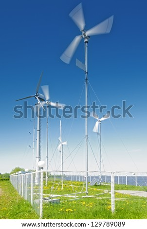 small wind turbines for wind farms - stock photo