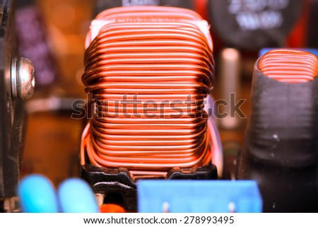 Small winding coils and capacitors are mounted on a baseplate. - stock photo