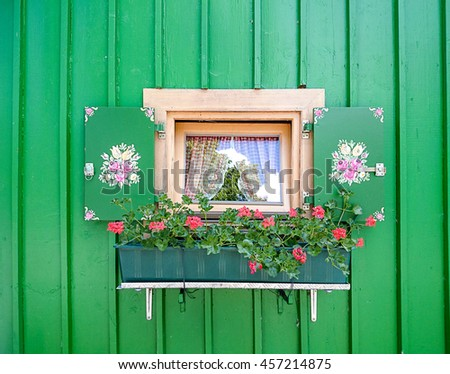 Small window with flowers painted by Bavarian style