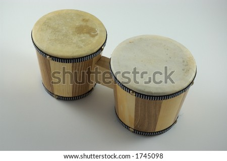 small wooden bongo drums on isolated white background - stock photo
